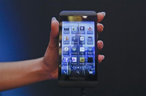A BlackBerry salesperson displays a BlackBerry Z10 during the launch of the BlackBerry 10 smartphone in Mumbai February 25, 2013. REUTERS/Vi