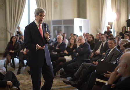 U.S. Secretary of State John Kerry speaks with French business leaders and entrepreneurs at the U.S. Ambassador Charles Rivkin's residence i