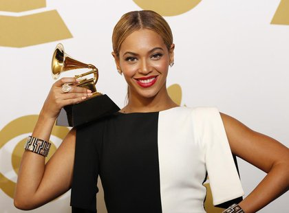 "Beyonce poses with her award for Best Traditional R&B Performance for ""Love On Top"" backstage at the 55th annual Grammy Awards in Los Angele"