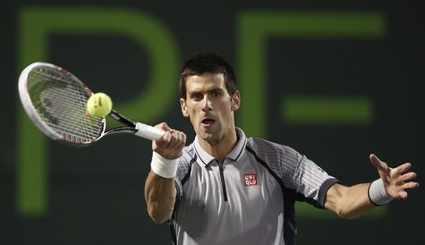 Serbia's Novak Djokovic returns a shot to Germany's Tommy Haas in their men's singles fourth round match at the Sony Open tennis tournament