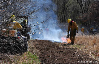 Wisconsin DNR workers carry out a prescribed burn (file photo)