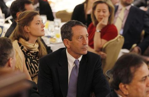 Former South Carolina Governor Mark Sanford (C) is pictured in the audience as U.S. President Barack Obama delivers remarks at the National