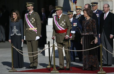 The Spanish royal family (L-R) Princess Letizia, Crown Prince Felipe, King Juan Carlos and Queen Sofia stand on the tribune during Epiphany