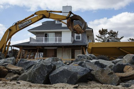 Heavy machinery moves large rocks to build a new sea wall nearly five months after the landfall of Superstorm Sandy in Bay Head, New Jersey,