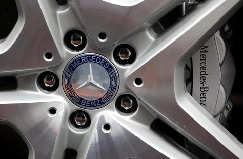 The company's logo is seen on the wheel of a Mercedes S-class limousine during a photo opportunity at the plant of German car manufacturer M