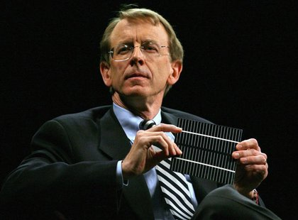 Venture capitalist John Doerr shows a flexible solar panel during a panel discussion at the 2006 TechNet Innovation Summit at the Stanford U