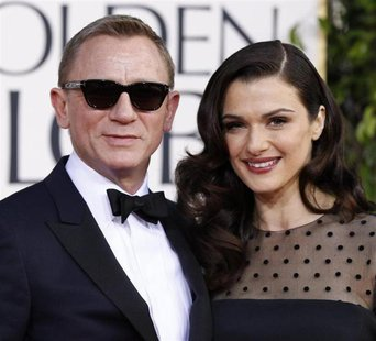 Actor Daniel Craig and his wife, actress Rachel Weisz, arrive at the 70th annual Golden Globe Awards in Beverly Hills, California, January 1