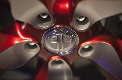 The Fisker automotive electric Atlantic sedan logo is seen on the car's tire during its unveiling ahead of the 2012 International Auto Show