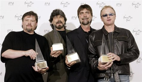"Members of the country band ""Alabama"" pose with their Award of Merit at the 30th annual American Music Awards in Los Angeles, January 13, 20"