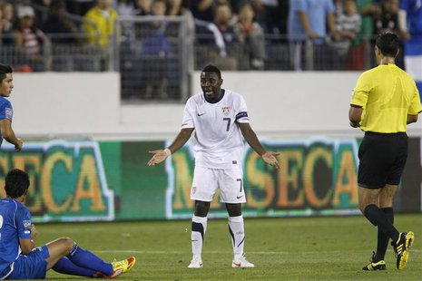 Freddy Adu of the U.S. (C) reacts to getting a yellow card during their CONCACAF Olympic qualifying soccer match against El Salvador in Nash