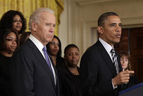 U.S. President Barack Obama (R) delivers remarks next to Vice President Joe Biden on common-sense measures to protect children from gun viol