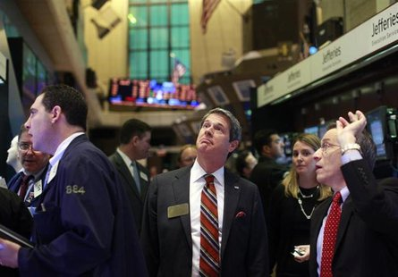 U.S. Senator David Vitter (R-LA) (C) and NYSE Chief Operating Office Larry Leibowitz (R) tour the floor of the New York Stock Exchange Janua
