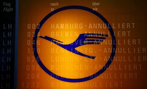 The logo of German air carrier Lufthansa and the cancelled flights on a flight schedule board are seen at the Fraport airport in Frankfurt,