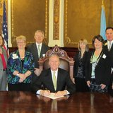 S.D. Governor Dennis Daugaard signs SB 235, creating the Housing Opportunity Fund. - Photo by SDHOF