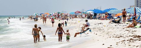 Tourists crowd the beach in Perdido Key, Florida May 19, 2012. REUTERS/Sean Gardner