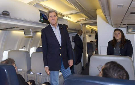 U.S. Secretary of State John Kerry talks to reporters after finding out that the aircraft had a mechanical failure before take off, at the A