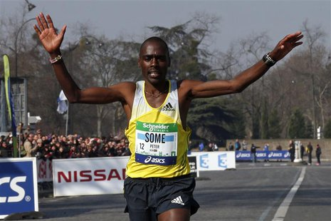 Kenya's Peter Some crosses the finish line to win the 37th Paris Marathon in Paris April 7, 2013. REUTERS/Benoit Tessier