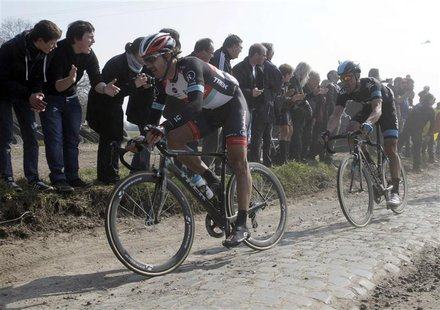 Fabian Cancellara of Switzerland (L) cycles on a cobble-stoned section during the Paris-Roubaix cycling race from Compiegne to Roubaix, Apri