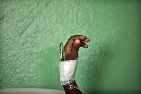 The hand of a child, who has been put on drip after showing symptoms of dengue fever, is seen in the pediatric emergency room of a public ho