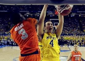 Michigan Wolverines forward Mitch McGary (4) dunks on Syracuse Orange forward Jerami Grant (3) in the first half of their NCAA men's Final Four basketball game in Atlanta, Georgia April 6, 2013. Reuters/Daniel J. Beauvais-Pool
