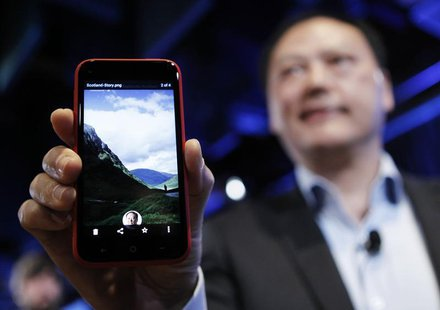 HTC CEO Peter Chou holds an HTC First phone showing the new app Facebook Home for Android during a press event in Menlo Park, California Apr