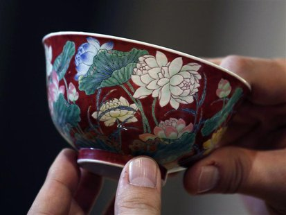 "A magnificent Ruby-Ground Falangcai ""Double-Lotus"" Bowl Blue Enamel Yuzhi Mark and Period of Kangxi is shown after Hong Kong Chinese ceramic"