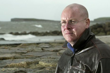 Britain's Nick Leeson stands on the shore of Galway Bay in this April 21, 2004 file photo. REUTERS/Paul McErlane/Files