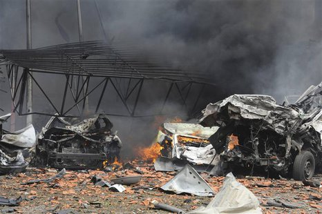A view shows wreckage of cars after a suicide car bomb exploded in the main business district of Damascus April 8, 2013, in this handout pho