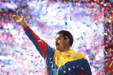 Venezuela's acting President and presidential candidate Nicolas Maduro waves to supporters during a campaign rally at the state of Bolivar,