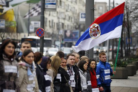 People block a street during an anti-European Union protest in Belgrade April 8, 2013. REUTERS/Marko Djurica