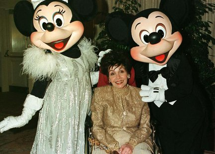 "Actress Annette Funicello poses with Disney characters ""Minnie Mouse "" (L) and ""Mickey Mouse"" during a VIP reception February 15, 1997 prior"