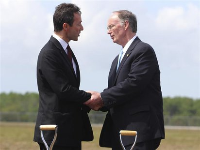 Fabrice Bregier, Airbus President and CEO shakes hands with Alabama Governor Robert Bentley (R), after breaking ground on its first U.S. ass