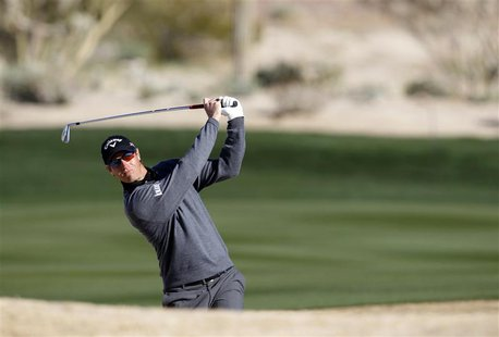 Nicolas Colsaerts of Belgium watches his second shot on the 7th hole during the third round of the WGC-Accenture Match Play Championship gol