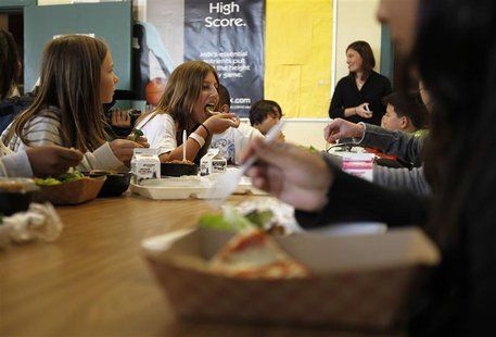 Students eat lunch in the cafeteria at a middle school in San Diego, California March 7, 2011. REUTERS/Mike Blake