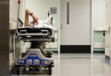 A patient waits in the hallway for a room to open up in the emergency room at a hospital in Houston, Texas July 27, 2009. REUTERS/Jessica Ri