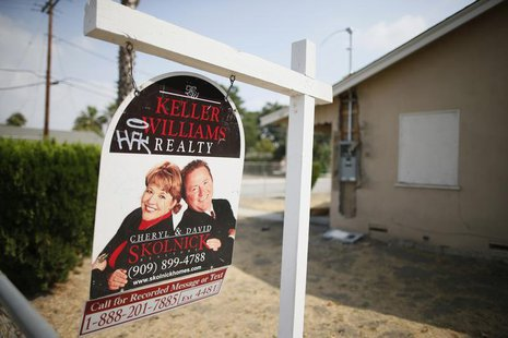 A real estate sign is seen outside a deserted home stripped of its copper wiring in San Bernardino, California September 11, 2012. REUTERS/L