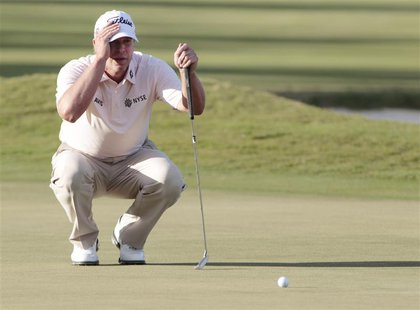 Steve Stricker of the U.S. lines up his putt on the 18th green during final round play in the 2013 WGC-Cadillac Championship PGA golf tourna