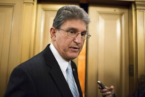 Senator Joe Manchin (D-WV) speaks to the media after a vote on Capitol Hill in Washington December 17, 2012. REUTERS/Joshua Roberts
