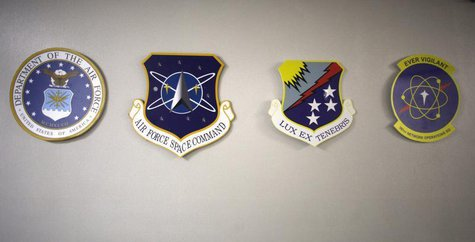 Medallions for (L-R) the U.S. Air Force, Air Force Space Command, Air Force Cyber Command and he Air Force Space Command Network Operations