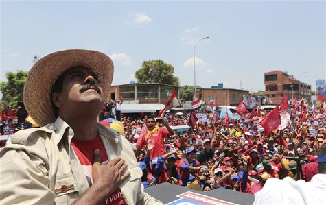 Venezuela's acting President and presidential candidate Nicolas Maduro greets supporters during a campaign rally at the state of Apure, in t