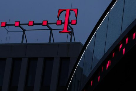 The logo of Deutsche Telekom AG is pictured at their headquarters, in this file photo taken in Bonn December 5, 2012. REUTERS/Ina Fassbender