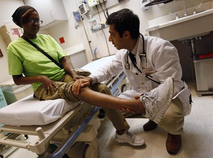 Patient Sharon Dawson Coates has her knee examined by Dr. Narang at University of Chicago Medicine Urgent Care Clinic in Chicago, June 28, 2