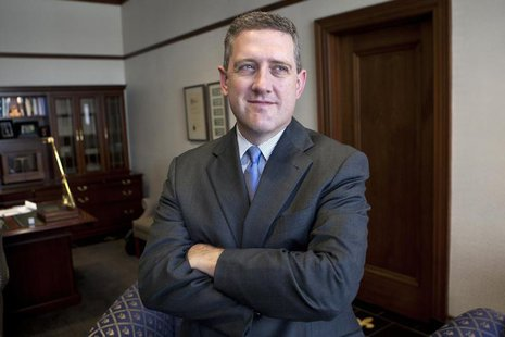 President and CEO of the Federal Reserve Bank of St. Louis James Bullard poses during an interview at the Federal Reserve Bank of St. Louis