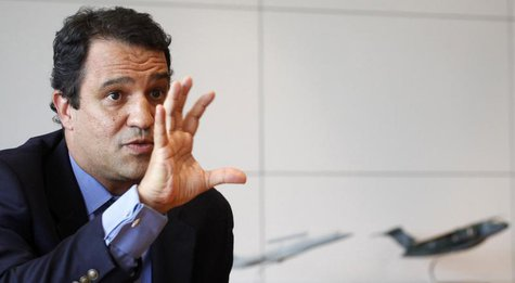 Luiz Carlos Aguiar, the head of Embraer's Defense and Security unit, speaks during an interview with Reuters in Sao Paulo January 13, 2012.