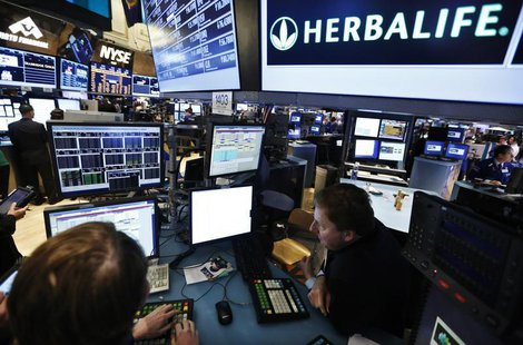 Traders work at the post that trades Herbalife stock on the floor of the New York Stock Exchange in this January 10, 2013 file photograph. R