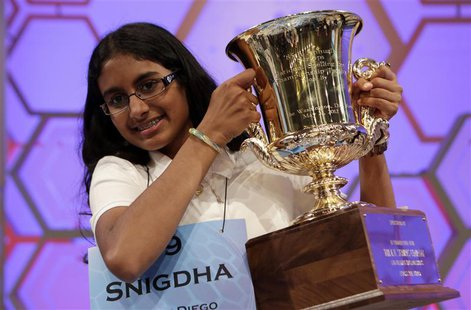 Snigdha Nandipati, 14, of San Diego, California, holds her trophy after winning the Scripps National Spelling Bee at National Harbor in Mary