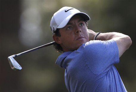 Rory McIlroy of Northern Ireland hits his tee shot on the fourth hole during a practice round in preparation for the 2013 Masters golf tourn