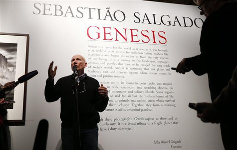 "Photographer Sebastiao Salgado talks to reporters at the preview of his exhibition ""Sebastiao Salgado: Genesis"" at the Natural History Museu"
