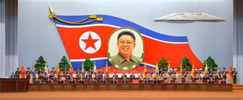 North Korean officials attend a national meeting to mark the 20th anniversary of late leader Kim Jong-il's election as chairman of North Kor
