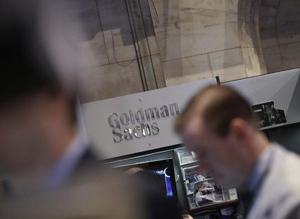 A Goldman Sachs sign is seen over the company's trading stall on the floor at the New York Stock Exchange, March 21, 2013. REUTERS/Brendan M